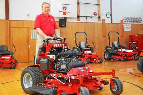 Philip Wenzel, vice president of commericial products at Briggs & Stratton Power Products Group-owned Ferris Industries, showcases the new stand-on commercial zero turn mower. John Brewer - Oneida Daily Dispatch